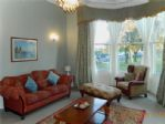 The spacious  lounge is south-facing with a big bay window  ...
