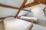 Mezzanine level bedroom: Twin children's beds