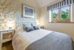 Ground floor: Master bedroom with views to side