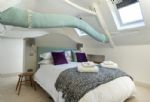 First floor: Bedroom with king size bed and en-suite bathroom
