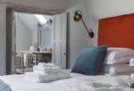 First floor: Bedroom with king-size bed and en-suite bathroom