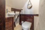 First floor:  En-suite  WC and wash basin