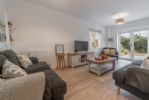 Ground Floor: Sitting room with french doors to rear garden