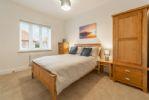 First Floor: Master bedroom has a double bed plus plenty of storage