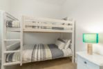 First floor: Bedroom three with full-size bunk beds