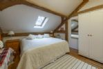 King-size bed with wardrobe and chest of drawers