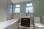 Ground floor: Bathroom with bath and fixed shower, wash basin and wc