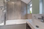 Ground floor: Bath with fixed shower