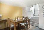 Ground floor: Dining room with steps to kitchen