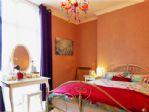 Distinctive lighting, attractive bed linen and tasteful presentation.