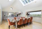 Ground floor: Elegant dining room with breath-taking panoramic windows