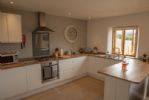 Lower ground floor: Open-plan fully fitted kitchen with views