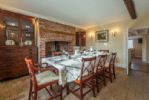 Ground floor: Dining room with wood burning stove and seating for eight.