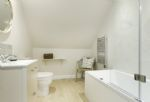 First floor: En-suite with bath tub and shower over