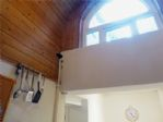 THE ARCHED HIGH WINDOW BRINGS IN LOTS OF NATURAL LIGHT