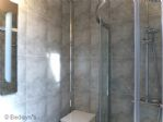 .. WITH A CORNER GLASS SHOWER ENCLOSURE, LOO &  BASIN