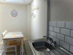 THERE'S A LOVELY DINING AREA OFF THE KITCHEN - WITH NATURAL LIGHT FROM A SKY-LIGHT