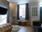 A GREAT FAMILY ROOM WITH WALL-MOUNTED TV & FREE WiFi