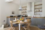 The Coach House: Kitchen and dining area with folding table and chairs