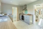 Ground floor: Kitchen with doors to entrance hall and utility area