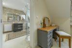 First floor: Master bedroom looking through to en suite shower room