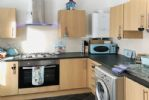 The cottage offers a modern and well-equipped kitchen ...