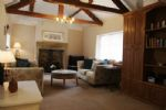 Beautiful and spacious lounge with wood burning stove at Forge Cottage in Masham