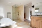 The master ensuite has a large shower and roll top bath