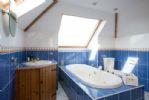 Top floor bathroom with jacuzzi bath