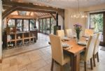 Ground floor:  View from the kitchen end of the open-plan dining and sitting area