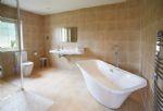 Ground floor: En-suite bathroom with separate shower