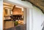 Thatcher's Cottage emits a cosy feel which is instantly welcoming to guests