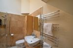 Thumbnail Image - The bathroom area with walk in wet room style shower