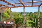 Thumbnail Image - The outside dining area overlooking the garden and countryside beyond