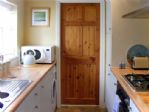 Kitchen with door to cloakroom