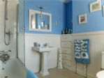 The lovely seaside-themed family bathroom