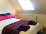 Second bedroom with en suite bathroom.