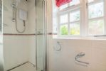 Ground floor: Shower room features an electric shower