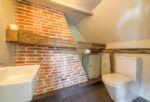 First floor:  En-suite  WC and hand basin