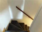 Stairwell, quite steep but comes with handrails.
