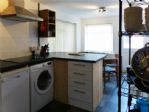 Kitchen includes washer and dishwasher.