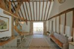 Thumbnail Image - The spacious and light ground floor area leading to the outside deck