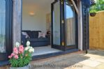 Thumbnail Image - The Cow Hide - The full length bi-fold doors leading to the stunning terrace