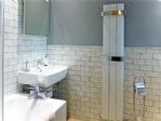 "The main ""family"" bathroom with bath and overhead shower."