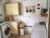 Couthie kitchen showing fridge & freezer