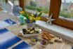 Enjoy dinner or breakfast with a stunning view in Mangle Cottage sunroom
