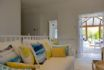 Mangle Cottage living area is light, open and bright with luxurious furniture