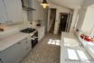 Minimalist practical well supplied kitchen