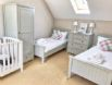Large twin bedroom with full size cot if required