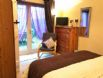 Downstairs Super King Double bedroom with access to courtyard